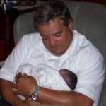 Mike Sr. and first granddaughter, Isabella